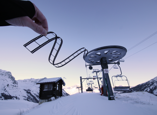 Film edge paperboard cutout in front of a ski lift in Tignes