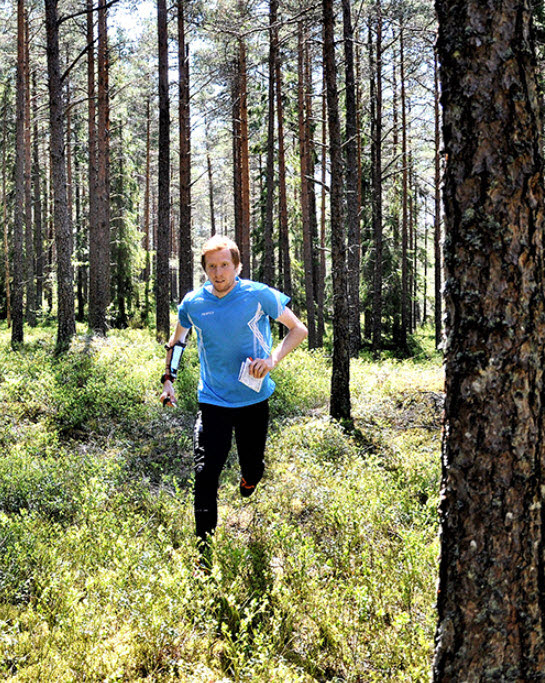 Orienteer running in forest