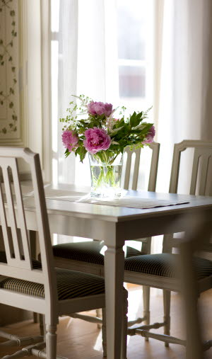 Close-up of dining table with bouquet of flowers