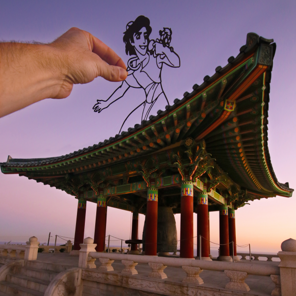 Alladin paperboard cutout in front of the Korean Bell of Friendship