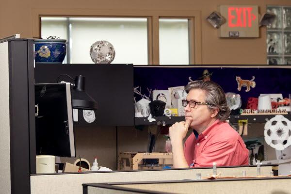 Erik Hluchan at desk at Structural Graphics