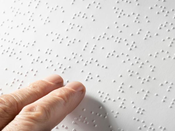Braille transcript embossed on paperboard