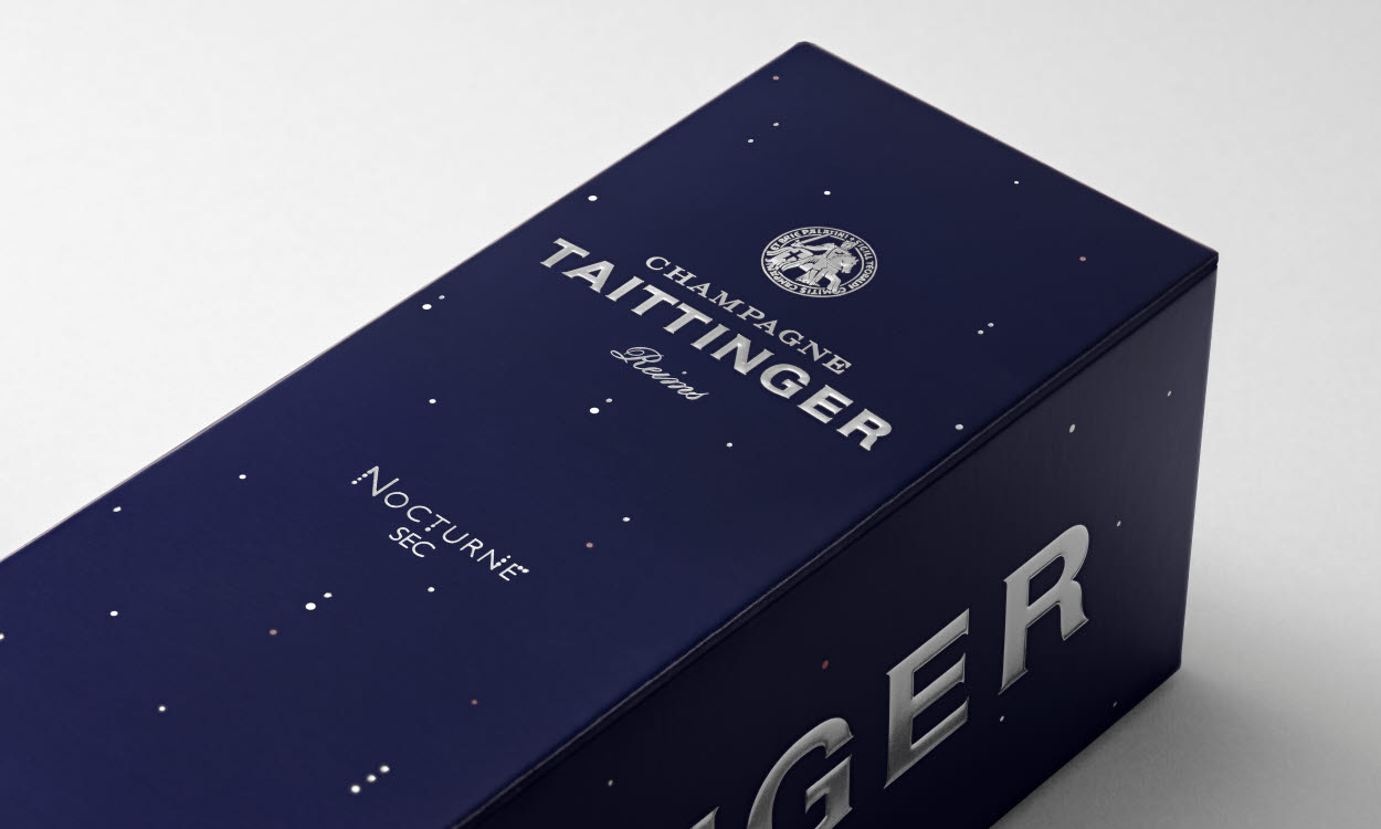 dark blue paperboard packaging for taittinger nocturne sec
