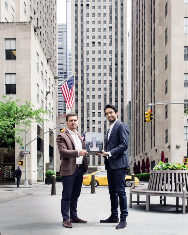 Mark J. Williams and colleague holding 3D pop-up book in New York street