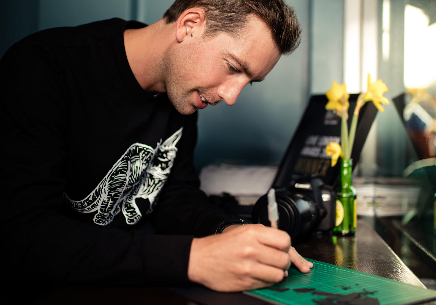 rich mccor working on paperboard cut-outs