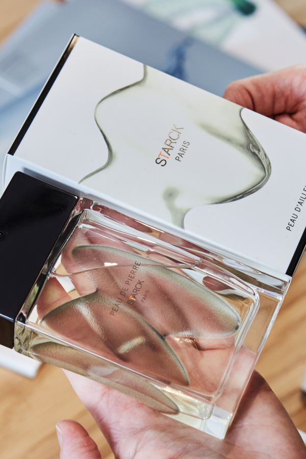 Starck Paris perfume and packaging in persons hands