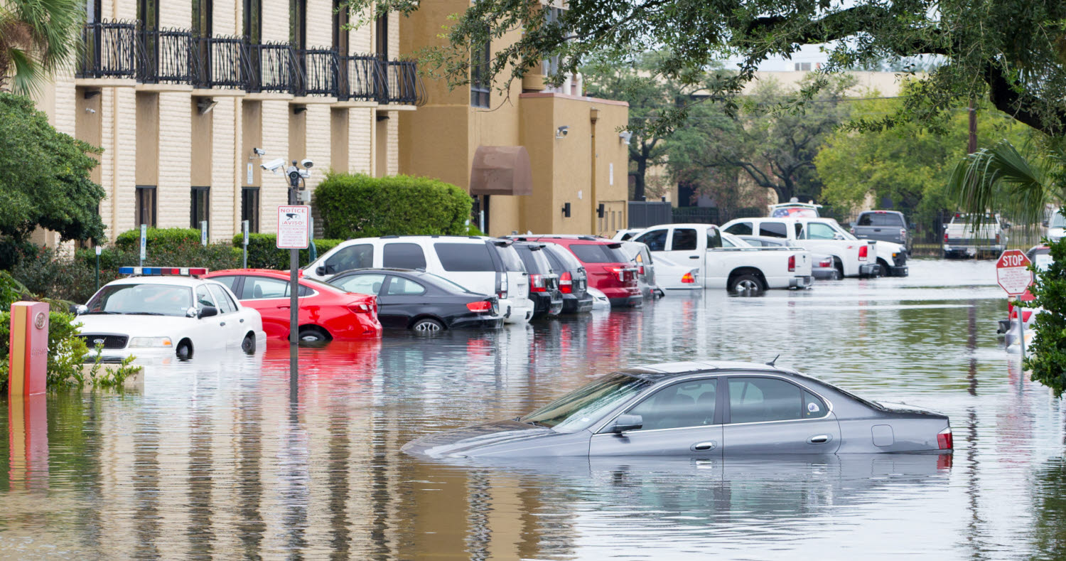 Flooded road with cars