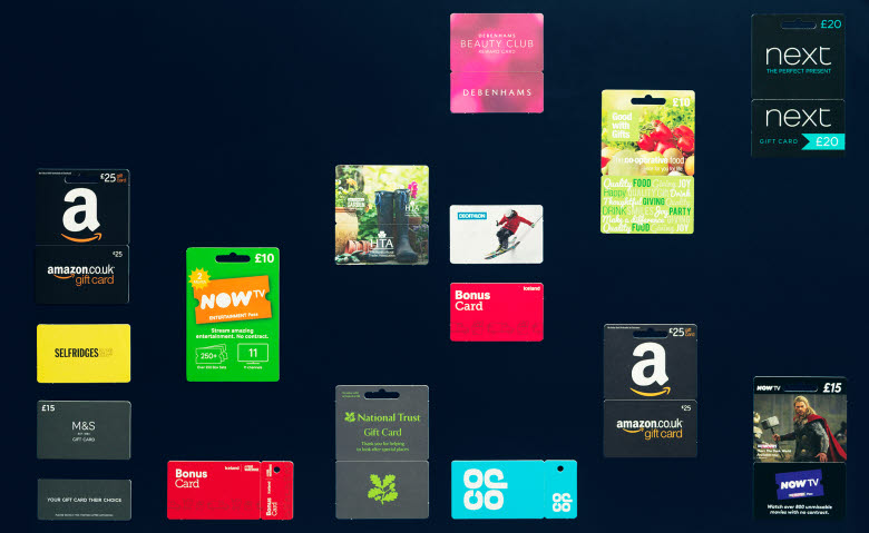 Different paperboard gift cards on dark background