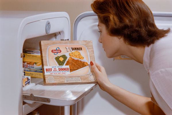 1950's illustration of woman taking out prepackaged food from freezer