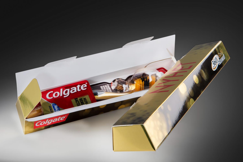 Golden Colgate toothbrush packaging