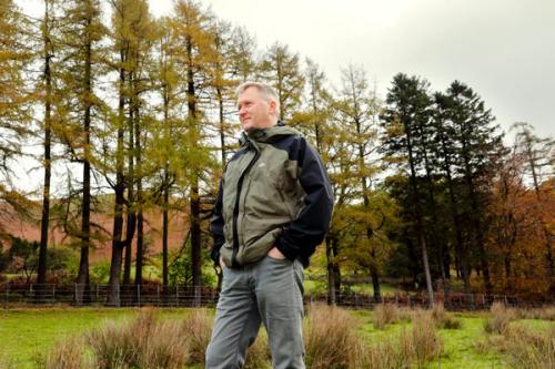 Ian Black standing in a green field