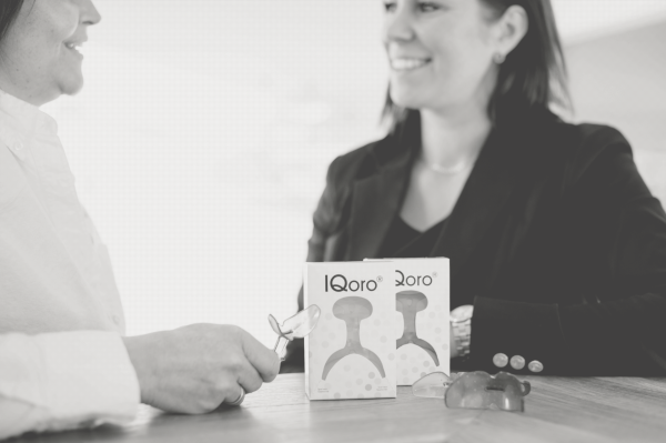 IQoro product and packaging on table with Ylvali Gerling and Agneta Wallner in black and white